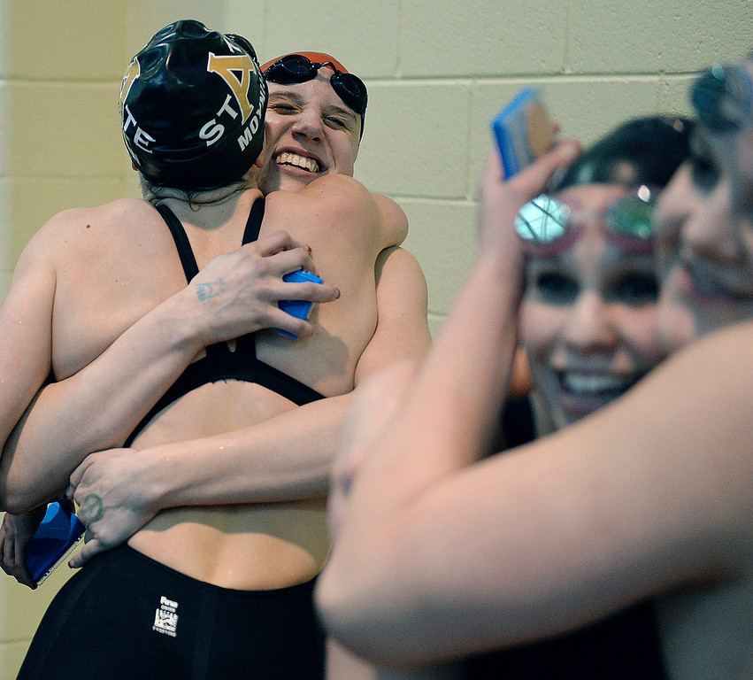 . THORNTON, CO. - FEBRUARY 15, 2014: Swimmers in the 200-yard freestyle event celebrated on the podium Saturday. The CHSAA 5A Girl\'s State Swimming Championships wrapped up Saturday night February 14, 2104.  Photo By Karl Gehring/The Denver Post