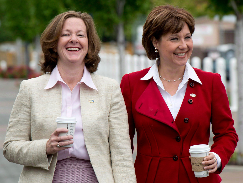 . British Columbia Premier Christy Clark, right, and Alberta Premier Alison Redford are seen prior to a closed door meeting in Kelowna, B.C. on June 14, 2013.   (AP Photo/The Canadian Press, Jonathan Hayward)