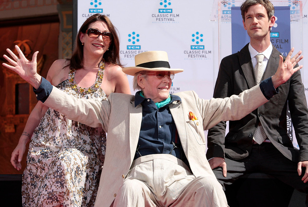 . Actor Peter O\'Toole, center, poses with his daughter Kate O\'Toole, left, and son Lorcan O\'Toole during his hand and footprint ceremony at Grauman\'s Chinese Theatre in Los Angeles on April 30, 2011.  O\'Toole, the charismatic actor who achieved instant stardom as Lawrence of Arabia and was nominated eight times for an Academy Award, has died. He was 81. O\'Toole\'s agent Steve Kenis says the actor died Saturday, Dec. 14, 2013 at a hospital following a long illness.(AP Photo/Jason Redmond)