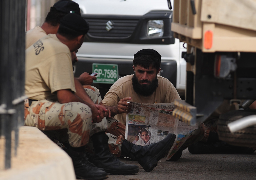 . A Pakistani Ranger reads a newspaper after a search operation following an assault by militants at Karachi airport terminal in Karachi on June 9, 2014. AFP PHOTO/Rizwan TABASSUM/AFP/Getty Images
