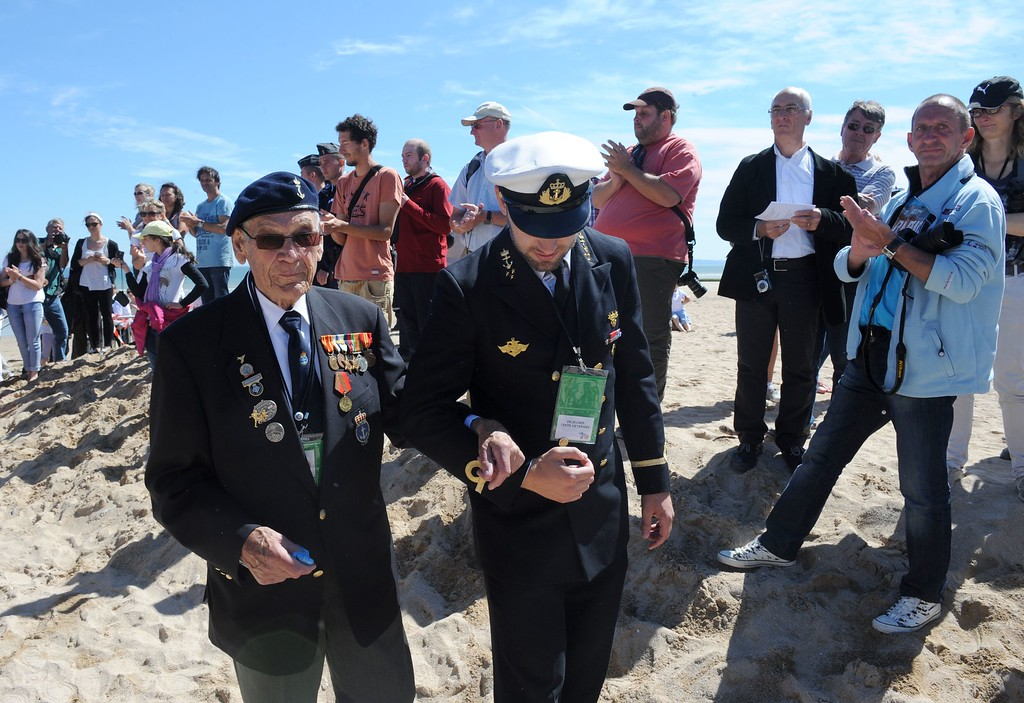 . Norwegian World War II veterans are welcomed as they arrive for a joint French-Norwegian D-Day commemoration ceremony in Hermanville-sur-Mer, Normandy, on June 6, 2014, marking the 70th anniversary of the World War II Allied landings in Normandy. AFP PHOTO / JEAN-FRANCOIS MONIER/AFP/Getty Images