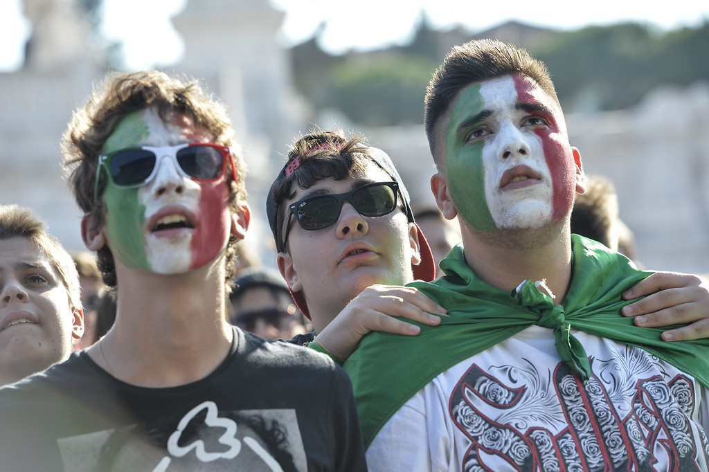 . Italian fans watch on a giant screen the World Cup football match Italy vs Costa Rica on June 20, 2014 on the Piazza Venezia square in Rome. AFP PHOTO / ANDREAS  SOLARO/AFP/Getty Images
