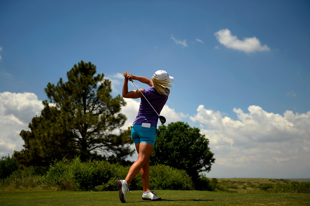 . Pernilla Lindberg of Sweden hits off the tee as she practices with the 2013 European Solheim Cup Team as they take a look at the Colorado Golf Club in Parker, Colorado. (Photo By Joe Amon/The Denver Post)