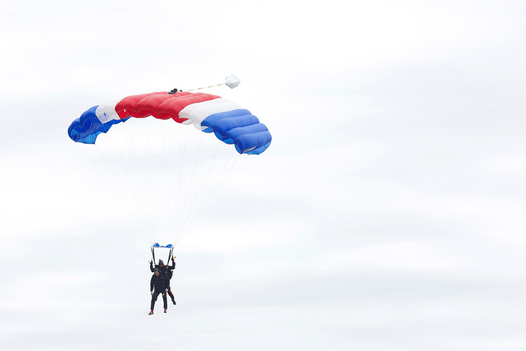 . Former U.S. President George H.W. Bush and Mike Elliott, US Army Sergeant 1st Class (ret), jump out of a helicopter and parachutes down to St. Anne\'s Episcopal Church on June 12, 2014 in Kennebunkport, Maine. The President is celebrating his 90th birthday today.   (Photo by Eric Shea/Getty Images)