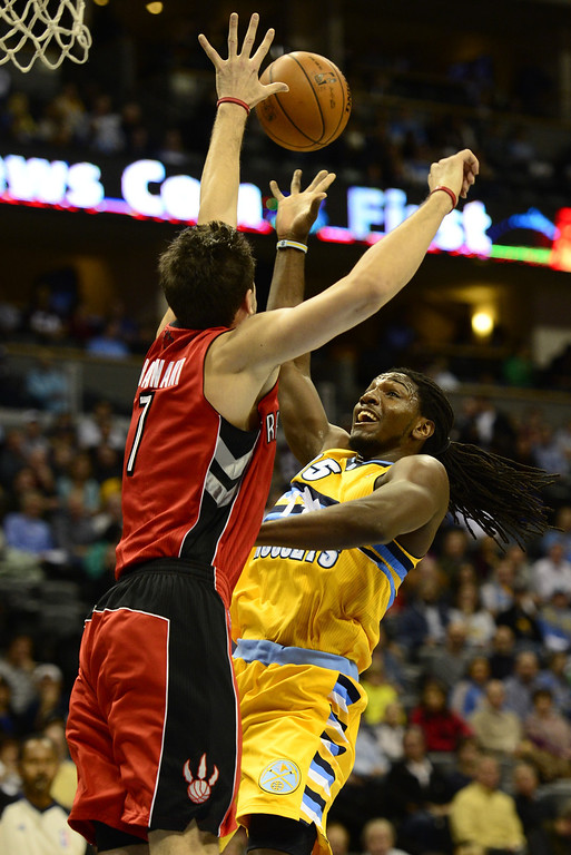 . Denver Nuggets forward Kenneth Faried is fouled during the first half against the Toronto Raptors at the Pepsi Center on Monday, December 3, 2012. AAron Ontiveroz/The Denver Post