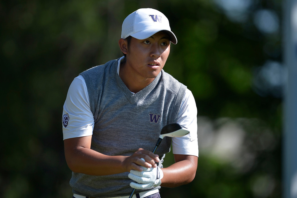 . Cheng-Tsung Pan of Taiwan watches his shot from the 16th tee during a continuation of the second round of the US Open at Merion Golf Club on June 15, 2013 in Ardmore, Pennsylvania.    AFP PHOTO/Brendan  SMIALOWSKI/AFP/Getty Images