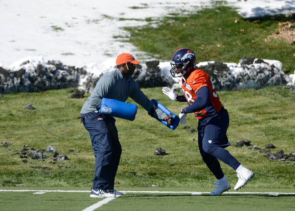 . Denver Broncos LB, Von Miller, right, during a drill at practice Friday morning, October 18, 2103.  (Photo By Andy Cross/The Denver Post)