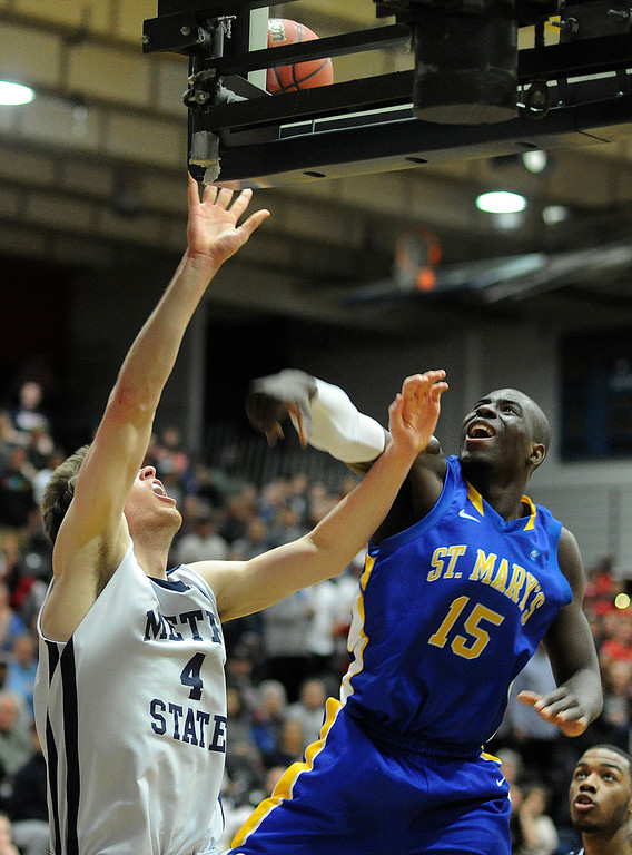 . DENVER, CO. - MARCH 19: Rattlers senior guard Moses Sundufu (15) rejected a shot by Roadrunners sophomore Nicholas Kay (4) in the first half. The Metro State men\'s basketball team hosted St. Mary\'s (Texas) in a RMAC playoff game Tuesday night, March 19, 2013. (Photo By Karl Gehring/The Denver Post)