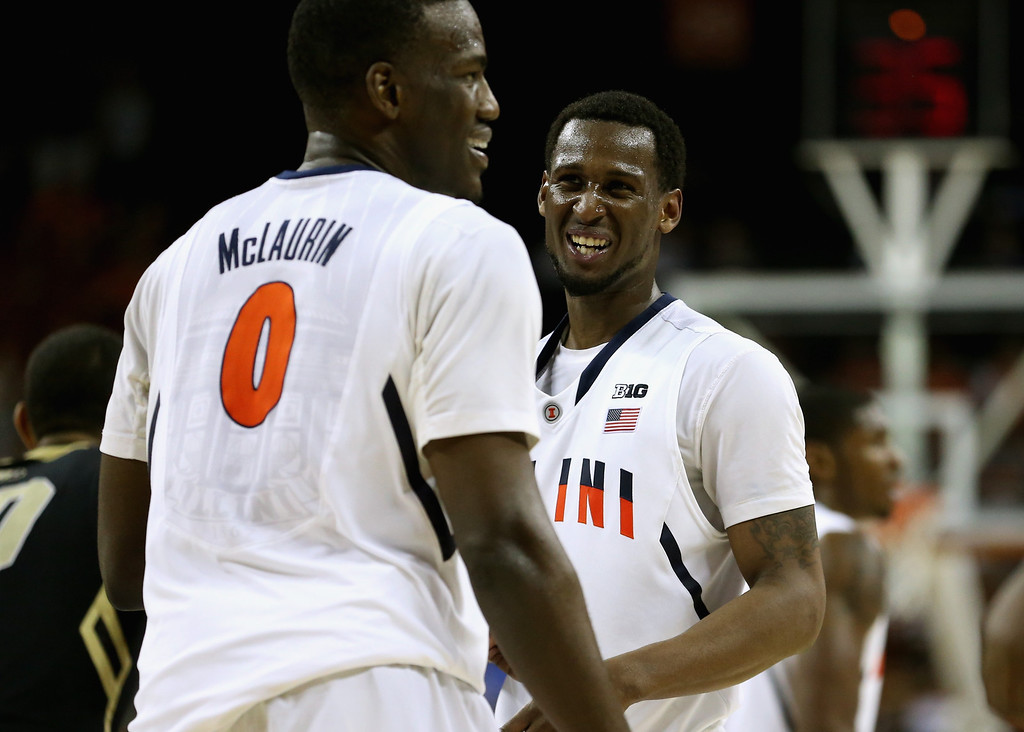. AUSTIN, TX - MARCH 22:  D.J. Richardson #1 and Sam McLaurin #0 of the Illinois Fighting Illini smile in the last minute of the game against the Colorado Buffaloes during the second round of the 2013 NCAA Men\'s Basketball Tournament at The Frank Erwin Center on March 22, 2013 in Austin, Texas.  (Photo by Ronald Martinez/Getty Images)