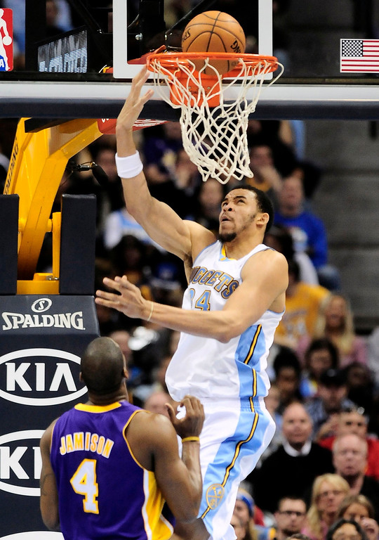 . Denver Nuggets\' JaVale McGee (R) scores over Los Angeles Lakers\' Antawn Jamison during their NBA basketball game in Denver, Colorado February 25, 2013.   REUTERS/Mark Leffingwell