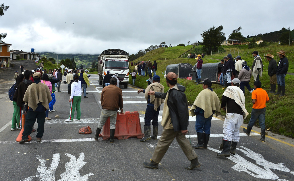 . Colombian farmworkers demanding government subsidies and greater access to land block the highway connecting Bogota and Tunja, in Ventaquemada, on August 20, 2013. Farmers who want Colombian President Juan Manuel Santos to set up a national dialogue to discuss land and other issues affecting farmworkers, are being joined by truckers, miners and health and education workers in nationwide roadblocks, rallies and demonstrations that began on Monday. LUIS ACOSTA/AFP/Getty Images