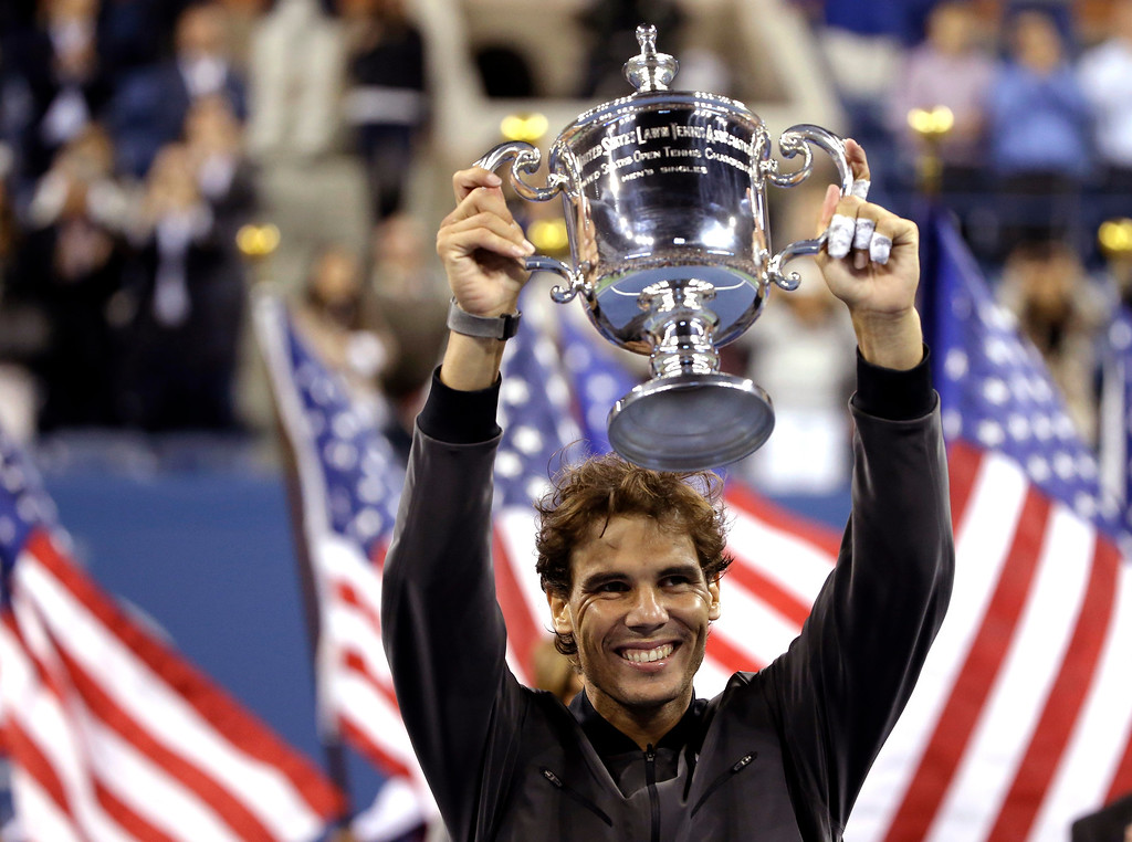 . Rafael Nadal, of Spain, holds up the championship trophy after beating Novak Djokovic, of Serbia, during the men\'s singles final of the 2013 U.S. Open tennis tournament, Monday, Sept. 9, 2013, in New York. (AP Photo/David Goldman)