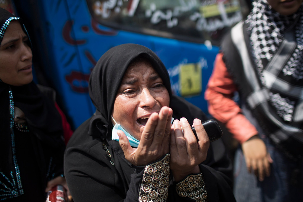 . A supporter of ousted Islamist President Mohammed Morsi reacts as she looks at a wounded people in Cairo\'s Nasr City district, Egypt, Wednesday, Aug. 14, 2013.  (AP Photo/Manu Brabo)