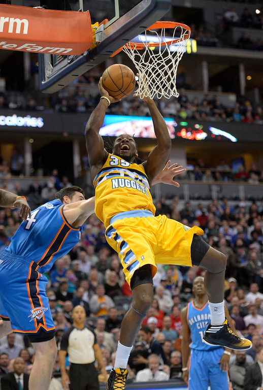 . DENVER, CO - DECEMBER 17:Denver Nuggets power forward Kenneth Faried (35) goes up for a tough shot past Oklahoma City Thunder power forward Nick Collison (4) during the second quarter  December 17, 2013 at Pepsi Center. (Photo by John Leyba/The Denver Post)