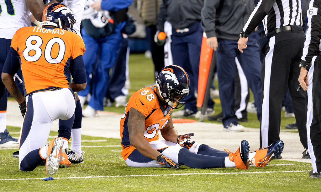 . Denver Broncos wide receiver Demaryius Thomas (88) reacts after fumbling the ball as Denver Broncos tight end Julius Thomas (80) looks on during the third quarter.  The Denver Broncos vs the Seattle Seahawks in Super Bowl XLVIII at MetLife Stadium in East Rutherford, New Jersey Sunday, February 2, 2014. (Photo by Hyoung Chang//The Denver Post)
