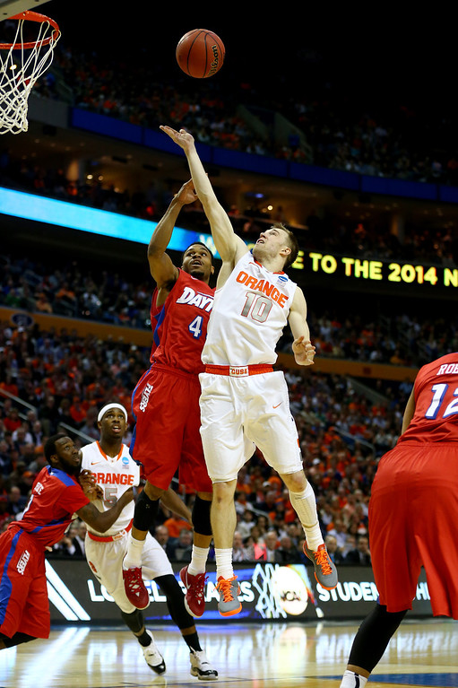 . BUFFALO, NY - MARCH 22: Trevor Cooney #10 of the Syracuse Orange goes up for a shot as Vee Sanford #43 of the Dayton Flyers defends during the third round of the 2014 NCAA Men\'s Basketball Tournament at the First Niagara Center on March 22, 2014 in Buffalo, New York.  (Photo by Elsa/Getty Images)