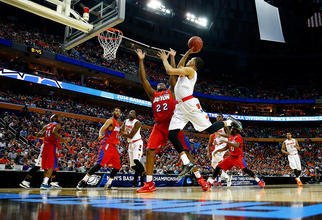 . BUFFALO, NY - MARCH 22: Tyler Ennis #11 of the Syracuse Orange takes a shot as Kendall Pollard #22 of the Dayton Flyers defends during the third round of the 2014 NCAA Men\'s Basketball Tournament at the First Niagara Center on March 22, 2014 in Buffalo, New York.  (Photo by Jared Wickerham/Getty Images)