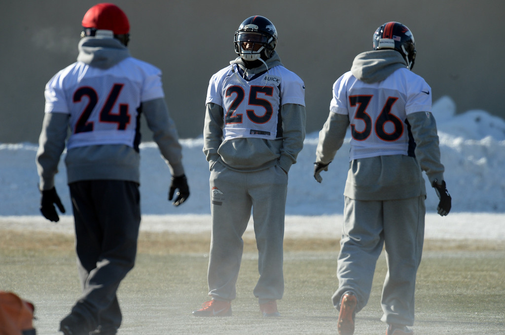 . From left, Champ Bailey (24), Chris Harris Jr.(25) and Kayvon Webster (36) warming up the practice field of Denver Broncos Headquarters at Dove Valley in Englewood, Colorado on Friday,  December 6, 2013. (Photo by Hyoung Chang/The Denver Post)