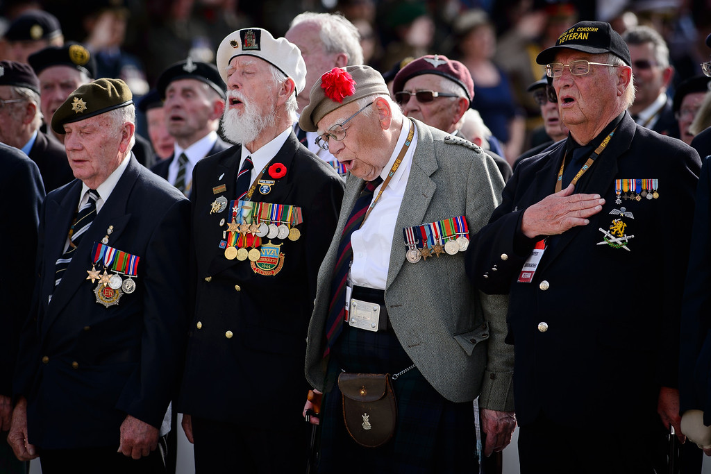 ". Veterans sing ""God Save The Queen\"" at an event in Arromanches-les-Bains, western France, Friday, June 6, 2014, marking the 70th anniversary of the World War II Allied landings in Normandy. World leaders and veterans gathered by the beaches of Normandy on Friday to mark the 70th anniversary of World War Two\'s D-Day landings. (AP Photo/Leon Neal, Pool)"