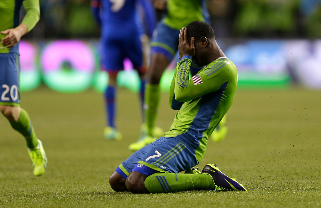 . Seattle Sounders\' Eddie Johnson falls to his knees after scoring a goal against the Colorado Rapids during stoppage time in a knockout-round match in the MLS Cup soccer playoffs on Wednesday, Oct. 30, 2013, in Seattle. The Sounders defeated the Rapids 2-0 and will advance to the Western Conference semifinals Saturday, Nov. 2, 2013, for a first of two aggregate match against the Portland Timbers. (AP Photo/Ted S. Warren)