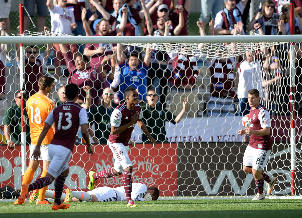 . Colorado Rapids forward Deshorn Brown (26) celebrates his goal as Houston Dynamo goalkeeper Tally Hall (1) lays on the ground dejected during the first half June 1, 2014 at Dick\'s Sporting Goods Park. (Photo by John Leyba/The Denver Post)