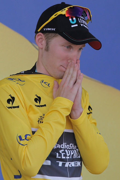 . Jan Bakelants of Belgium, wearing the overall leader\'s yellow jersey, celebrates on the podium of the third stage of the Tour de France cycling race over 145.5 kilometers (91 miles) with start in Ajaccio and finish in Calvi, Corsica island, France, Monday July 1, 2013. (AP Photo/Christophe Ena)