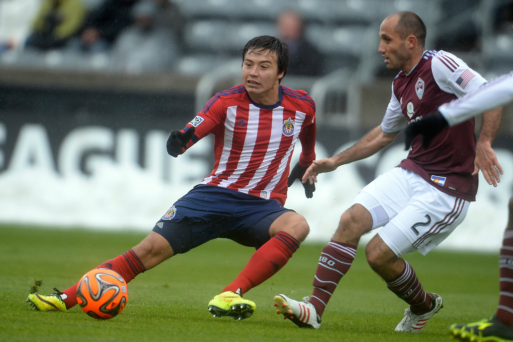 . Erick Torres (9) of Chivas USA controls the ball as Nick LaBrocca (2) of Colorado Rapids defends during the second half. Chivas USA defeated the Colorado Rapids 3-1 on Sunday, May 11, 2014. (Photo by AAron Ontiveroz/The Denver Post)