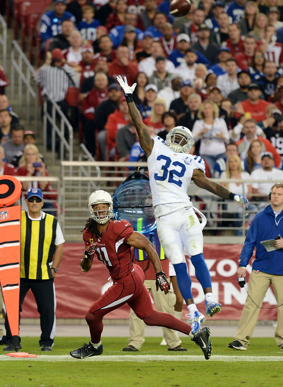 . Larry Fitzgerald #11 of the Arizona Cardinals looks to make a catch while being defended by Cassius Vaughn #32 of the Indianapolis Colts at University of Phoenix Stadium on November 24, 2013 in Glendale, Arizona.  (Photo by Norm Hall/Getty Images)