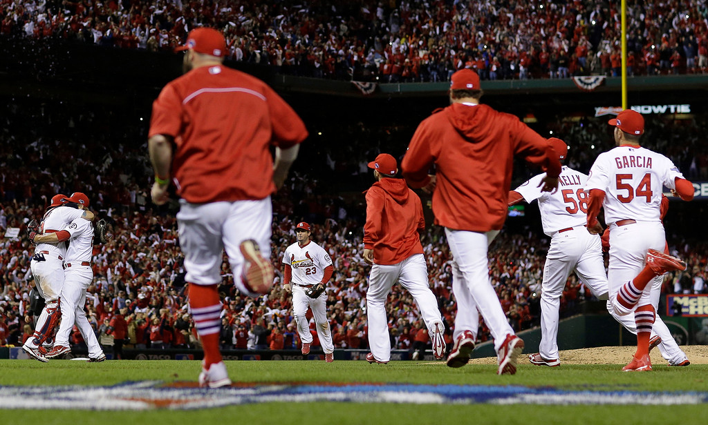 . St. Louis Cardinals catcher Yadier Molina and Trevor Rosenthal, embrace after Game 6 of the National League baseball championship series against the Los Angeles Dodgers Friday, Oct. 18, 2013, in St. Louis. The Cardinals won 9-0 to win the series. (AP Photo/Jeff Roberson)