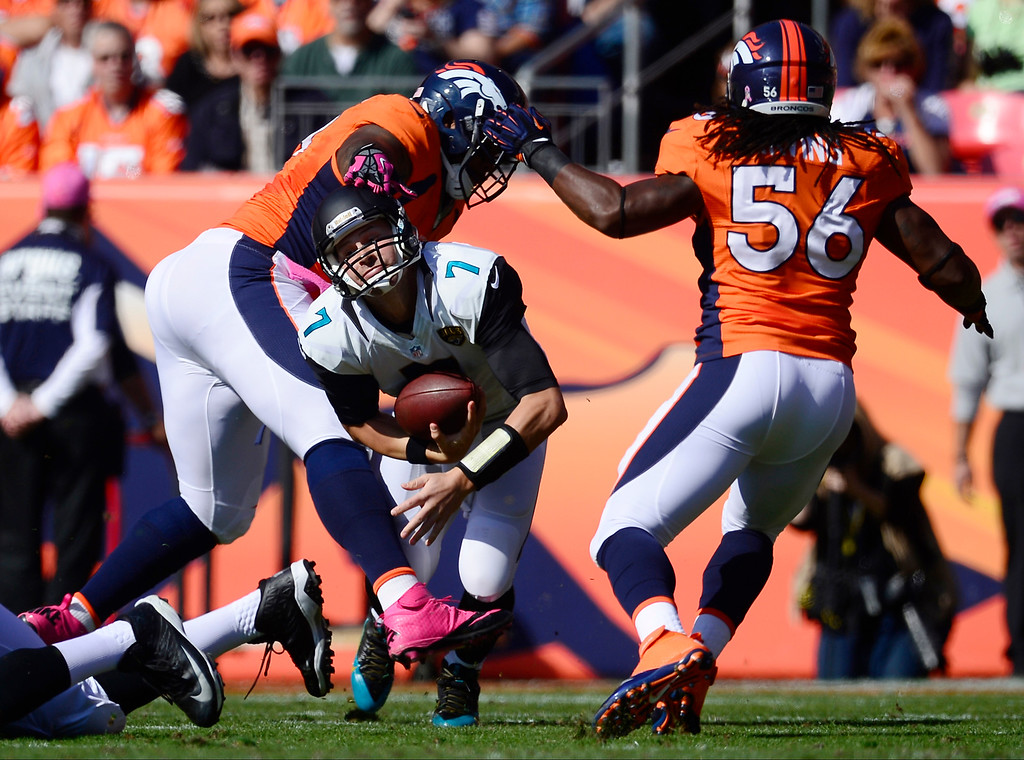 . Jacksonville Jaguars quarterback Chad Henne (7) gets sacked by Denver Broncos defensive tackle Kevin Vickerson (99) in the first quarter.  (Photo by AAron Ontiveroz/The Denver Post)