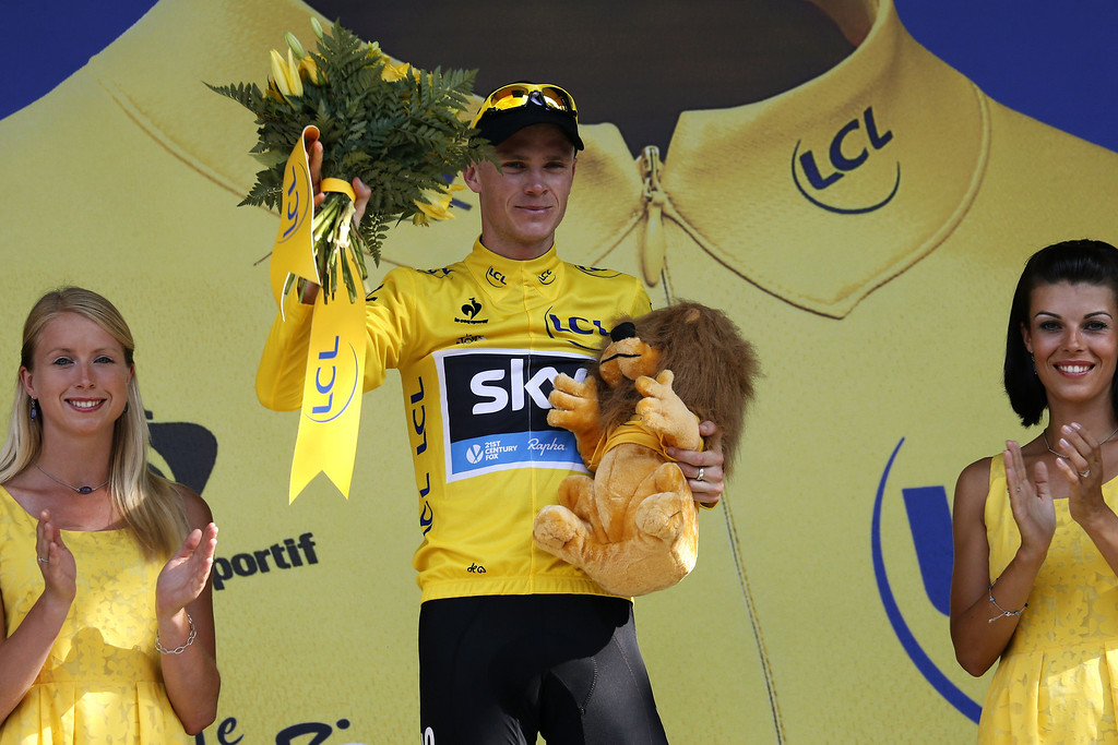 . Britain\'s Christopher Froome celebrates his overall leader\'s yellow jersey on the podium at the end of the 168 km sixteenth stage of the 100th edition of the Tour de France cycling race on July 16, 2013 between Vaison-la-Romaine and Gap, southeastern France.   PASCAL GUYOT/AFP/Getty Images