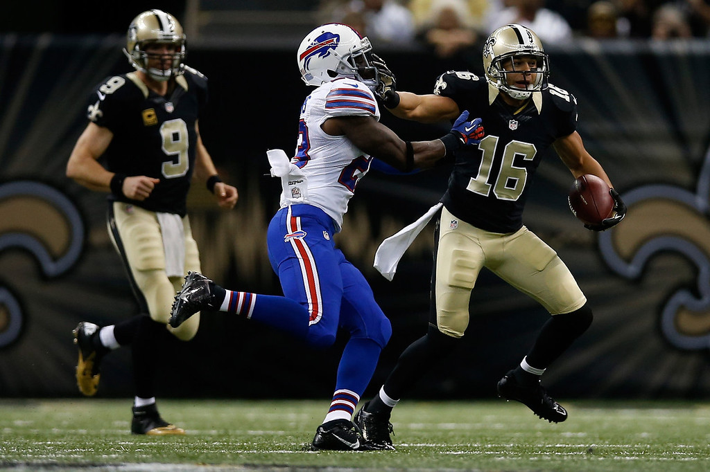 . Pierre Thomas #23 of the New Orleans Saints is tackled by  Aaron Williams #23 of the Buffalo Bills at Mercedes-Benz Superdome on October 27, 2013 in New Orleans, Louisiana.  (Photo by Chris Graythen/Getty Images)