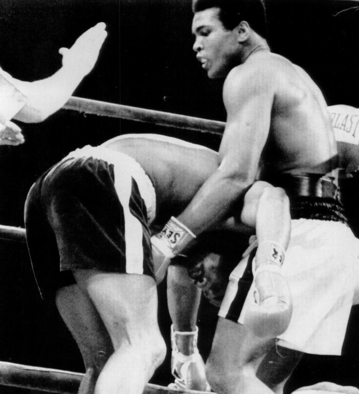 . Muhammad Ali (R) , seems to be holding Ken Norton up in a corner in the fifth round of their return match at the forum. Ali won the match in a split decision making it 1 and 1. 1973. Denver Post Library photo archive