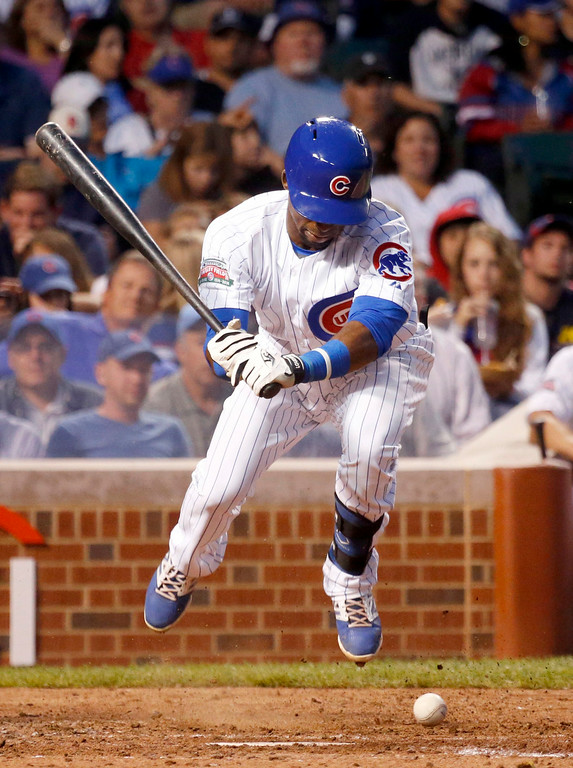 . Chicago Cubs\' Arismendy Alcantara is hit by a pitch from Colorado Rockies starting pitcher Jorge De La Rosa during the second inning of a baseball game Tuesday, July 29, 2014, in Chicago. (AP Photo/Charles Rex Arbogast)