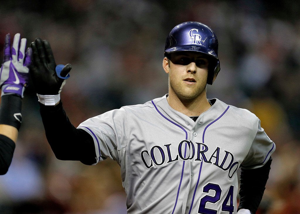 . Colorado Rockies pitcher Jordan Lyles crosses home plate after hitting a home run against the Arizona Diamondbacks during the third inning of a baseball game on Wednesday, April 30, 2014, in Phoenix. (AP Photo/Matt York)