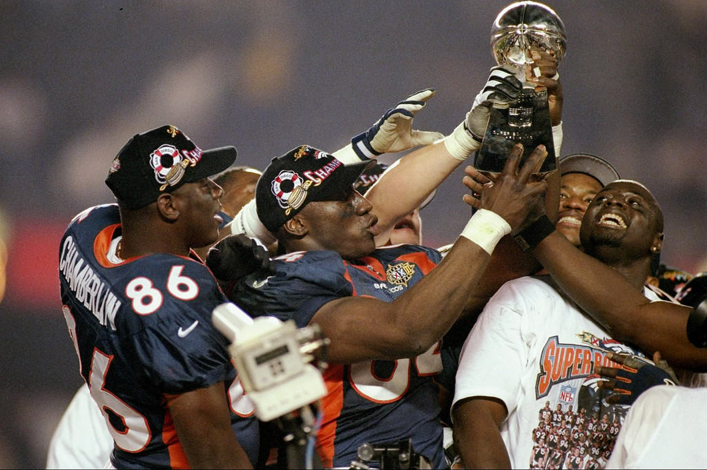 . Shannon Sharpe #84 and teammates hold up the Lombardi Trophy after defeating the Green Bay Packers in Super Bowl  XXXII at Qualcomm Stadium in San Diego, California.  The Denver Broncos defeated the Green Bay Packers 31-24.