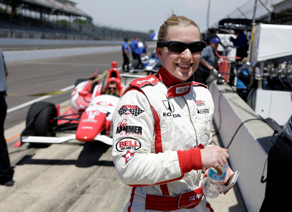 . Pippa Mann, of England, smiles after she drove during practice for the Indianapolis 500 auto race at the Indianapolis Motor Speedway in Indianapolis, Wednesday, May 15, 2013. (AP Photo/Michael Conroy)