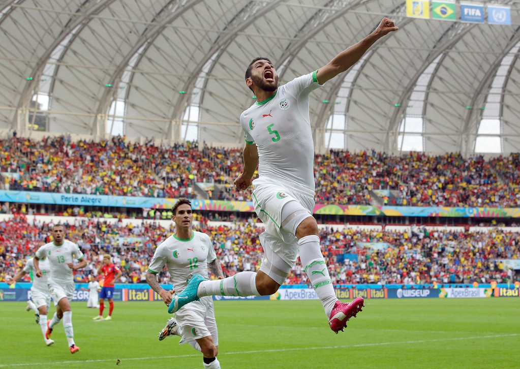 . Algeria\'s Rafik Halliche (5) celebrates after scoring his side\'s second goal during the group H World Cup soccer match between South Korea and Algeria at the Estadio Beira-Rio in Porto Alegre, Brazil, Sunday, June 22, 2014. (AP Photo/Lee Jin-man)