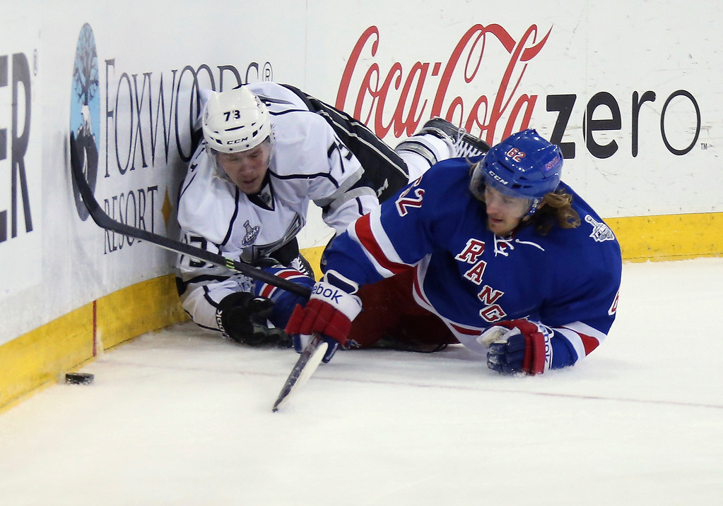 . Tyler Toffoli #73 of the Los Angeles Kings and Carl Hagelin #62 of the New York Rangers lie on the ice after a collision during the first period of Game Four of the 2014 NHL Stanley Cup Final at Madison Square Garden on June 11, 2014 in New York, New York.  (Photo by Bruce Bennett/Getty Images)