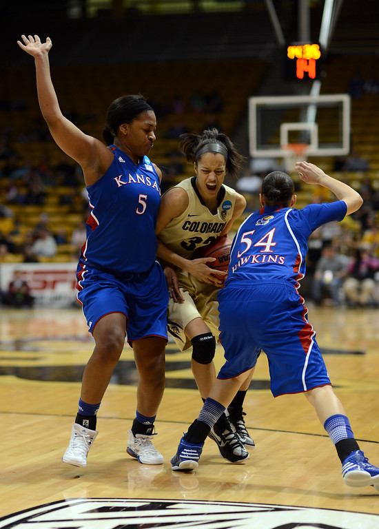 . BOULDER, CO. - MARCH 23: Arielle Roberson of Colorado Buffaloes (32), center, trying to control the ball between 	Catherine Williams (5), left, and 	Markisha Hawkins (54) of Kansas Jayhawks during the first round of the 2013 NCAA women\'s Basketball Tournament at Coors Events Center. Boulder, Colorado. March 23, 2013. Kansas won 67-52. (Photo By Hyoung Chang/The Denver Post)