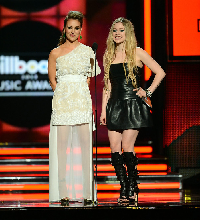 . Presenters Alyssa Milano and Avril Lavigne speak onstage during the 2013 Billboard Music Awards at the MGM Grand Garden Arena on May 19, 2013 in Las Vegas, Nevada.  (Photo by Ethan Miller/Getty Images)