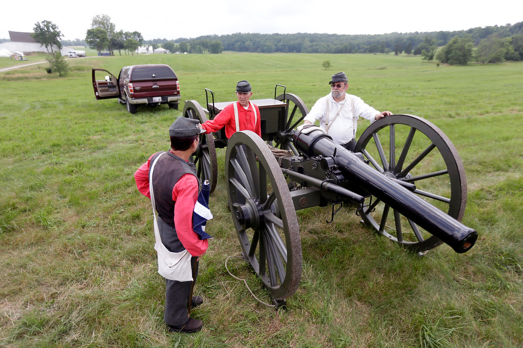 . Members of the 4th Maryland Light Artillery unload their weapon in the Artillery park during ongoing activities commemorating the 150th anniversary of the Battle of Gettysburg, Thursday, June 27, 2013, in Gettysburg, Pa. (AP Photo/Matt Rourke)
