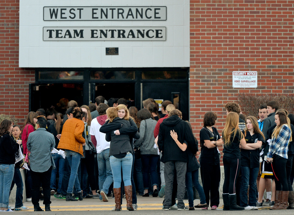 . Seniors gather outside Arapahoe High School in Centennial, CO December 19, 2013. Seniors and Juniors returned to the school for two hour periods Thursday, Sophomores and Freshmen will return on Friday. The victim from Friday�s shooting at Arapahoe High School, Claire Davis, 17, remains in critical condition. She was shot on Friday when classmate Karl Pierson opened fire in the school. The gunman died from a self-inflicted gunshot wound. (Photo By Craig F. Walker / The Denver Post)