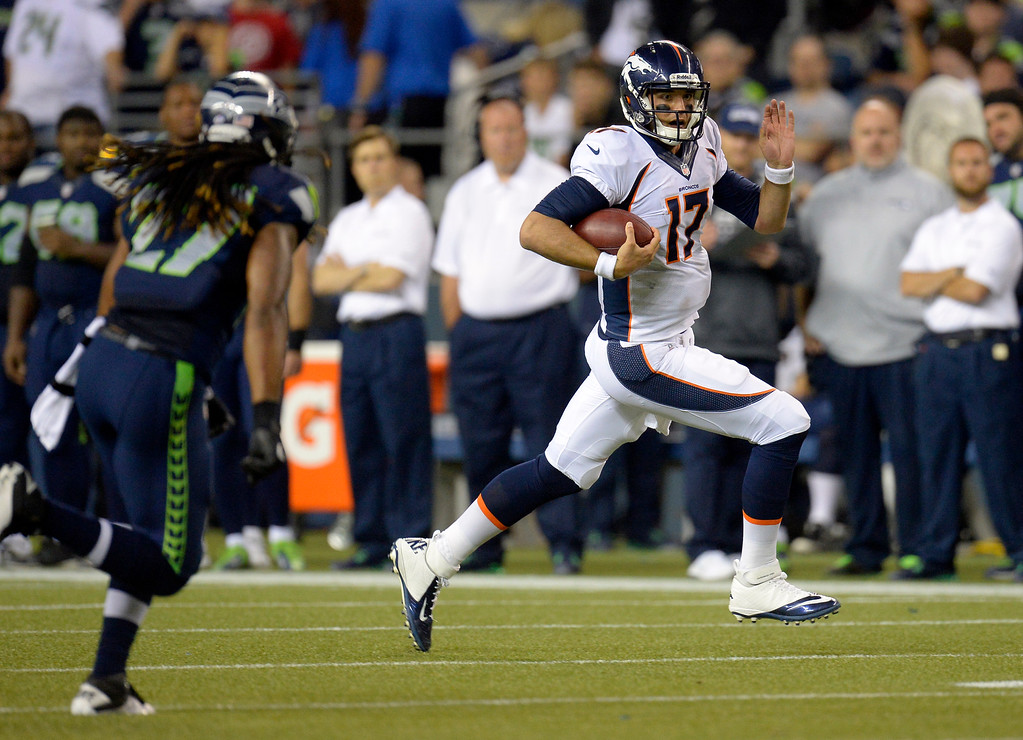 . SEATTLE, WA. - AUGUST 17: Denver Broncos quarterback Brock Osweiler (17) scrambles for a big gain as he gets chased by Seattle Seahawks strong safety Winston Guy (27) during the foruth quarter August 17, 2013 at Century Link Field. (Photo By John Leyba/The Denver Post)