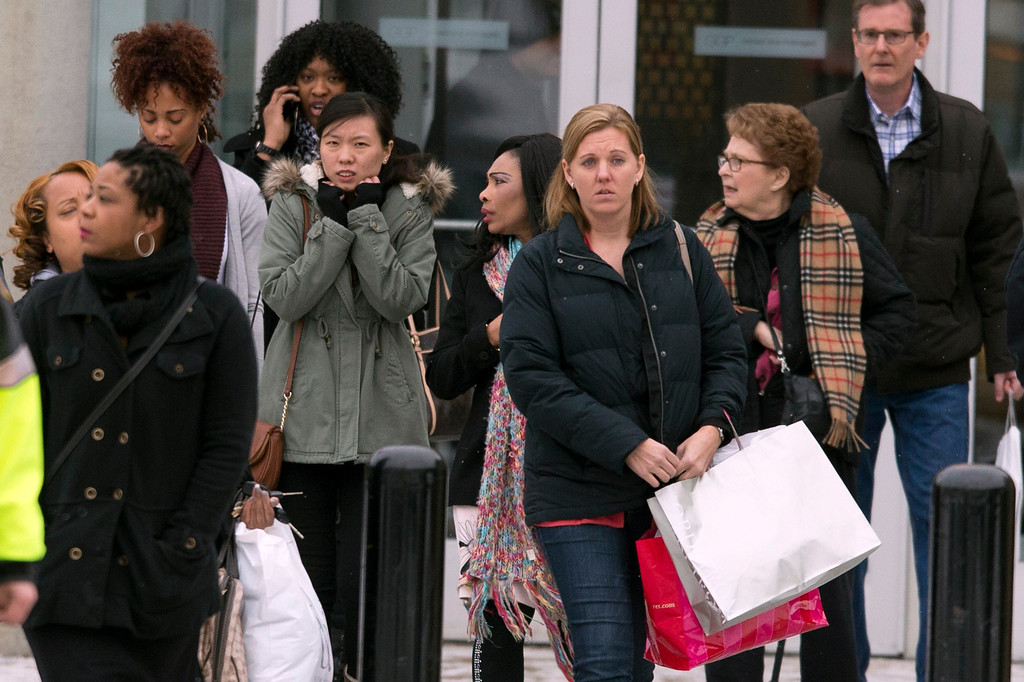 . Shoppers are evacuated by police after a shooting at The Mall in Columbia on Saturday, Jan. 25, 2014, in Columbia, Md. Police say three people died in a shooting at the mall in suburban Baltimore, including the presumed gunman. (AP Photo/ Evan Vucci)