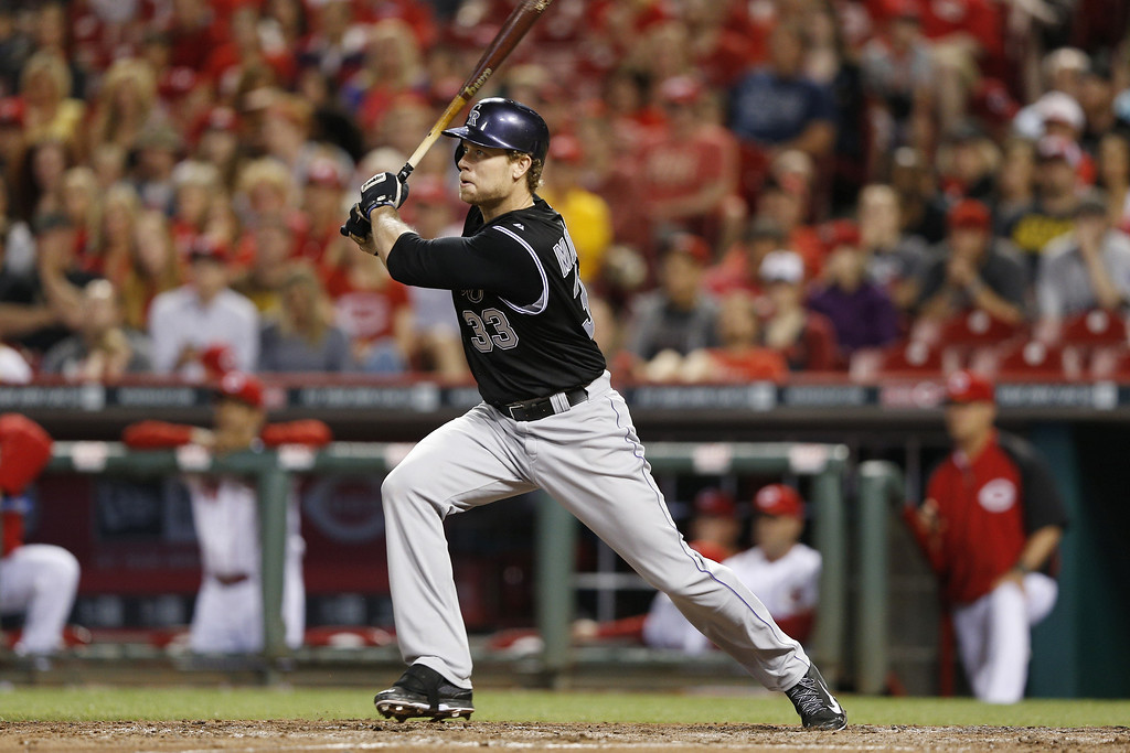 . CINCINNATI, OH - MAY 9: Justin Morneau #33 of the Colorado Rockies doubles to drive in the tying run in the top of the ninth inning of the game against the Cincinnati Reds at Great American Ball Park on May 9, 2014 in Cincinnati, Ohio. The Reds won 4-3. (Photo by Joe Robbins/Getty Images)