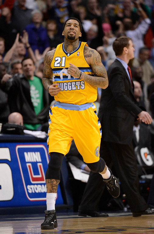 . Denver Nuggets shooting guard Wilson Chandler (21) looks up after hitting the game winner in overtime to defeat the Portland Trail Blazers 115-111 Tuesday, January 15, 2013 at Pepsi Center. John Leyba, The Denver Post