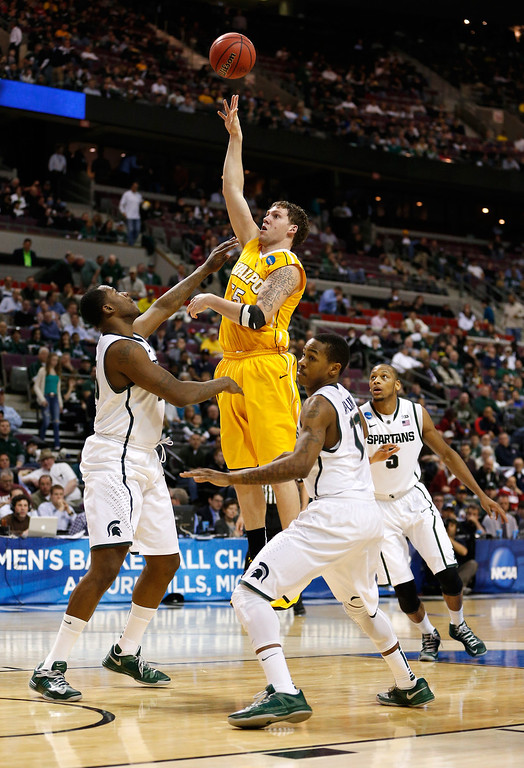 . Kevin Van Wijk #55 of the Valparaiso Crusaders attempts a shot in the second half against the Michigan State Spartans during the second round of the 2013 NCAA Men\'s Basketball Tournament at at The Palace of Auburn Hills on March 21, 2013 in Auburn Hills, Michigan.  (Photo by Gregory Shamus/Getty Images)
