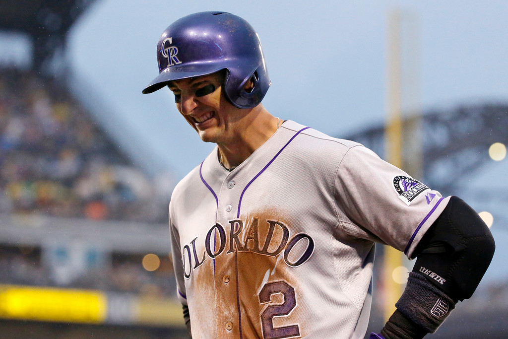 . Colorado Rockies shortstop Troy Tulowitzki (2) grimaces as he walks back to the dugout after grounding out to end the fourth inning of a baseball game against the Pittsburgh Pirates in Pittsburgh Saturday, July 19, 2014. Tulowitzki left the game.(AP Photo/Gene J. Puskar)