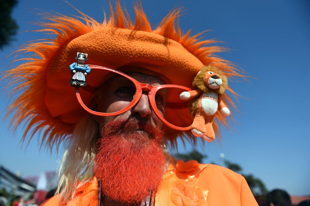 . A fan of the Netherlands, who drived his truck from California to Brazil, poses outside the Arena Corinthias in Sao Paulo,  on June 22, 2014,  on the eve of the Group B football match between Chile and the Netherlands during the 2014  FIFA World Cup 2014.  EITAN ABRAMOVICH/AFP/Getty Images